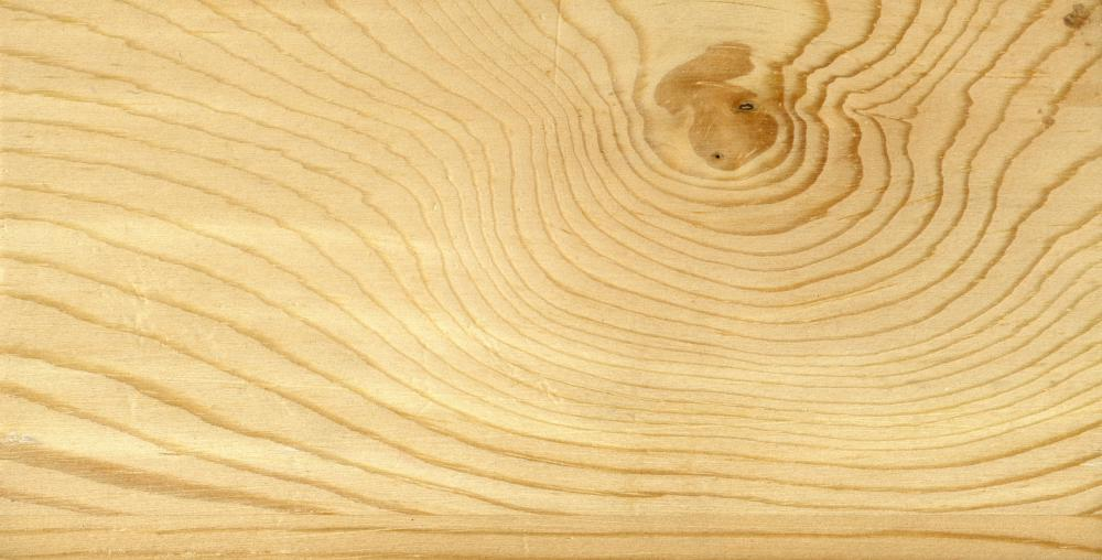 A veneer is a thin layer of wood applied on top of a lesser quality material.